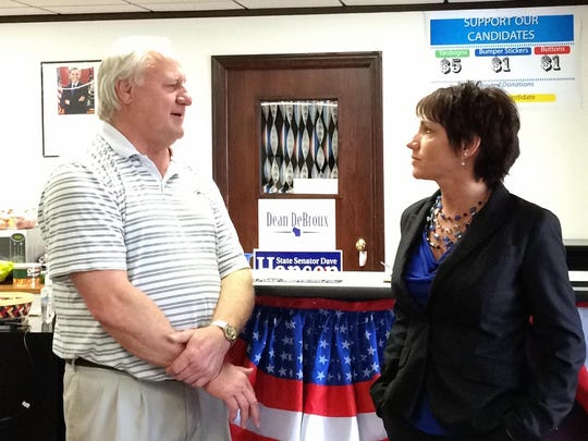 Democratic Attorney General candidate Susan Happ speaks with Sen. Dave Hansen, D-Green Bay, while campaigning in Green Bay.
