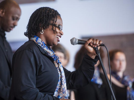 Deborah Hughley, Chaplain at Malmstrom Air Force Base, sings with the Great Falls Community Gospel Choir during a Martin Luther King, Jr. Day celebration.
