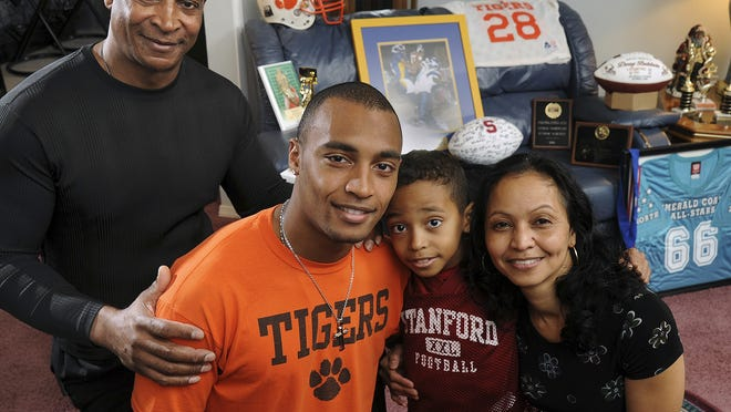 Doug Baldwin, Sr., left, pictured with his sons, Doug Baldwin, Jr., and Devon Baldwin, 8, and wife, Cindy Baldwin, in 2010.