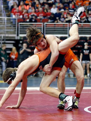 Solon's Cole Fritz, right, defeats Mason Buster of Mediapolis in a 138-pound 2A bout Friday at Wells Fargo Arena in Des Moines.