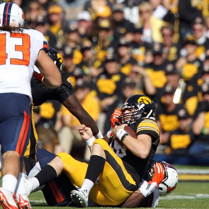 Iowa quarterback C.J. Beathard gets brought down by