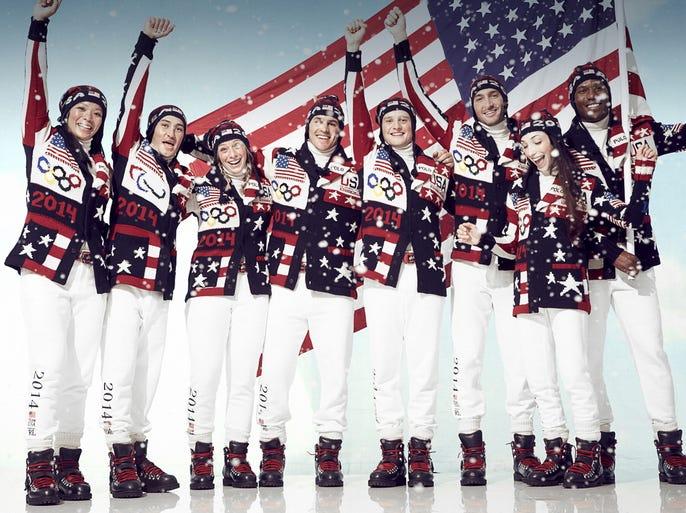 USA Olympians show off their opening ceremony uniforms. From left to right: Julie Chu, Mike Shea, Hannah Kearney, Zach Parise, Charlie White, Evan Lysacek, Meryl Davis, Shani Davis.