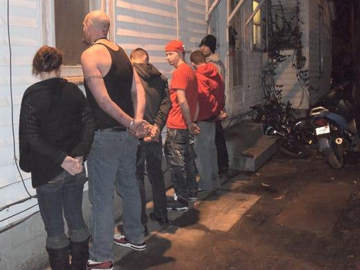 Police raid home again, arrest 5