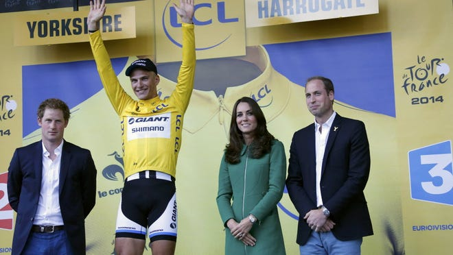 Germany's Marcel Kittel, the first yellow jersey wearer in this year's Tour de France, gets a round of royal congratulations from Princes Harry and William and Duchess Catherine.