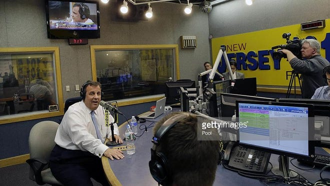 "New Jersey Gov. Chris Christie sits in a studio during his radio program, ""Ask the Governor"" broadcast on NJ 101.5, Monday on Feb. 3, 2014. When appearing on the show April 20, 2016, Christie gave details of his trip to Indiana. Donald Trump wants the endorsement of Indiana Gov. Mike Pence, calling in Christie to make a quick trip to the Hoosier State to help bring Pence on board. (AP Photo/Mel Evans,Pool)"