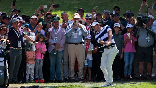 Rory McIlroy of Northern Ireland follows his approach to the first green during the third round for the WGC-Mexico Championship golf tournament, at the Chapultepec Golf Club in Mexico City, Saturday, Feb. 22, 2020.