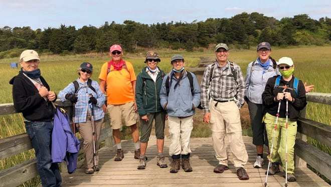 Mary O'Connor, second from the right, of Brewster led a 6.8-mile walk exploring the  trail around Pochet island on Sept. 15. Did you ever see a friendlier group?