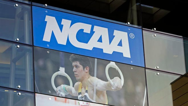 "In this April 25, 2018, file photo, the NCAA headquarters is shown in Indianapolis. More than a dozen national associations in various sports - hockey, soccer, tennis, golf, swimming and gymnastics, among them - have signed a memo outlining ""significant concerns"" about effects of allowing athletes to profit for use of their names, images and likenesses (NIL)."