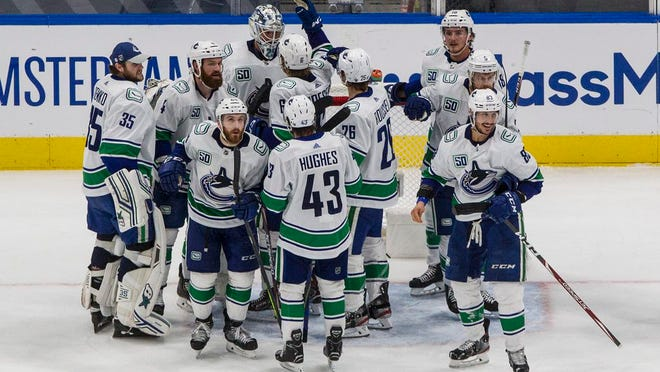 Vancouver Canucks celebrate win over the St. Louis Blues in Game 5 of an NHL hockey first-round playoff series in Edmonton, Alberta, Wednesday, Aug. 19, 2020.