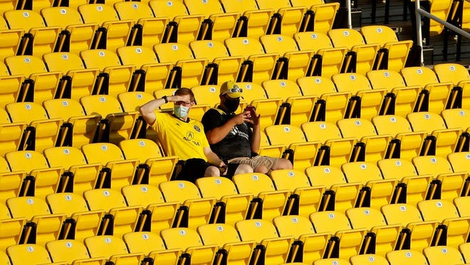Early arriving fans take their seats prior to the MLS soccer match between Columbus Crew SC and FC Cincinnati at Mapfre Stadium in Columbus on Sunday, Sept. 6, 2020. The team allowed 1,500 fans to attend the match.