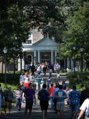 Students head to class at Parrish Hall via Magill Walk