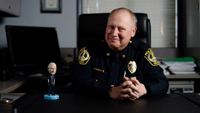 York Area Regional Police Chief Tom Gross is retiring in December. Here, he poses with a bobblehead doll made to look like him, given to the chief by an officer.