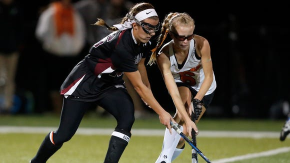 Mamaroneck's Elizabeth Brissette (6 in white), shown battling Scarsdale's Erin Nicholas (l) in the 2016 playoffs, is expected to be one of the Tigers' top players this season.