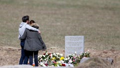 Relatives of the victims of the air crash visit the