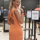 April Nelson, Miss Louisiana 2015, departs from Monroe Regional Airport for the Miss America Pageant.