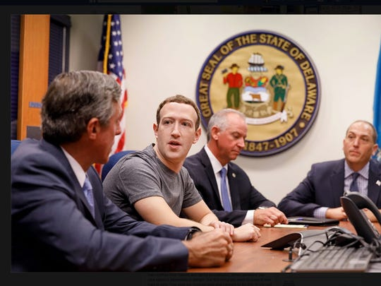 Mark Zuckerberg, second from left, meets with state officials on Monday, including Gov. John Carney.  Zuckerberg is touring the country in an attempt to meet more Americans.