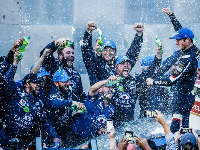 Kasey Kahne and his crew celebrate their win at the