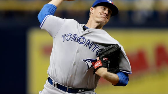 Toronto Blue Jays' Tom Koehler pitches to the Tampa Bay Rays during the first inning of a baseball game Thursday, Aug. 24, 2017, in St. Petersburg, Fla. (AP Photo/Chris O'Meara)