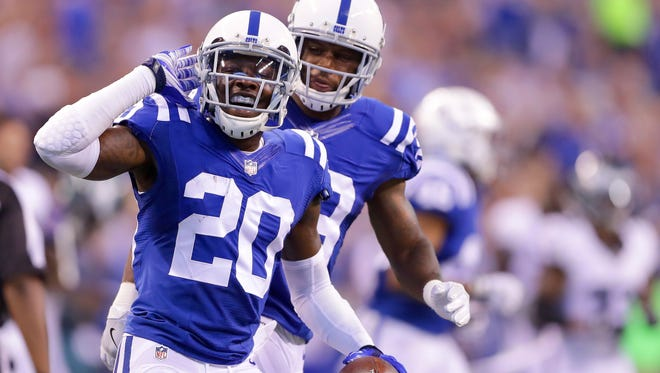 Indianapolis Colts cornerback Darius Butler (20) celebrates with teammate Mike Adams (29) after pulling down a tipped ball for an interception during the first half of an NFL football game Saturday, Aug. 27, 2015, at Lucas Oil Stadium.