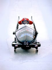 Brian Shimer (front) drives his two-man bobsled during a practice run before the 2002 Winter Olympics in Salt Lake City, Utah.