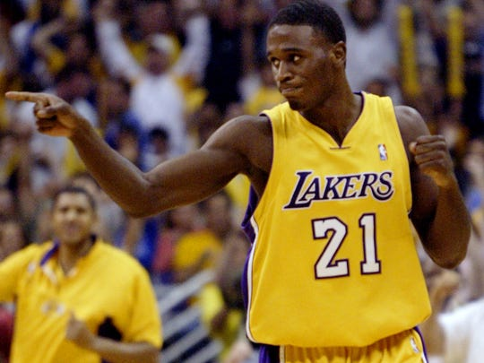 Los Angeles Lakers' Kareem Rush celebrates after hitting a 3-point shot in the second half of Game 6 of the NBA Western Conference Finals against the Minnesota Timberwolves, Monday, May 31, 2004, in Los Angeles. Rush scored 18 points off the bench as the Lakers won 96-90 to advance to the NBA Finals.