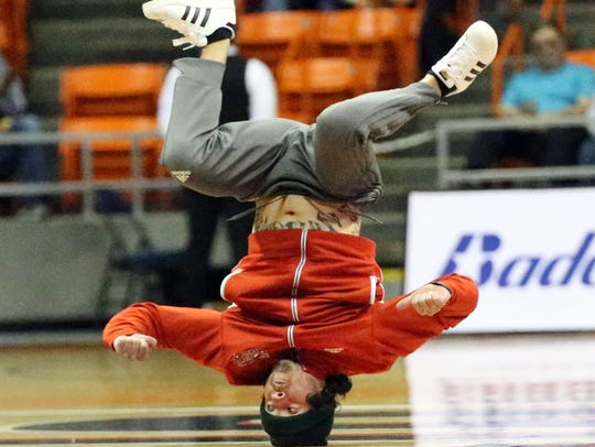 A member of the Globie Crew spins on his head as part of the pregame entertainment before the Harlem Globetrotters game in the Don Haskins Center last year.