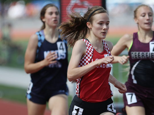 Emily Foley earned three medals at the WIAA state track