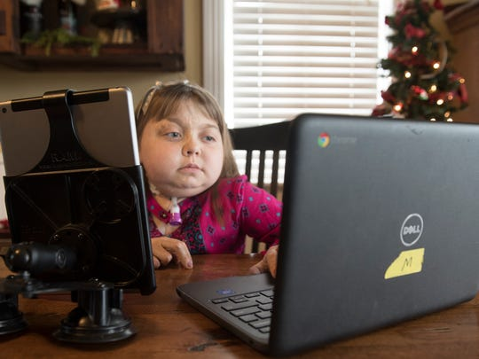 Reese Burdette studies remotely during a school lesson at her Mercersburg home. Burdette recently received a new kidney and is back home, getting ready for the holidays.