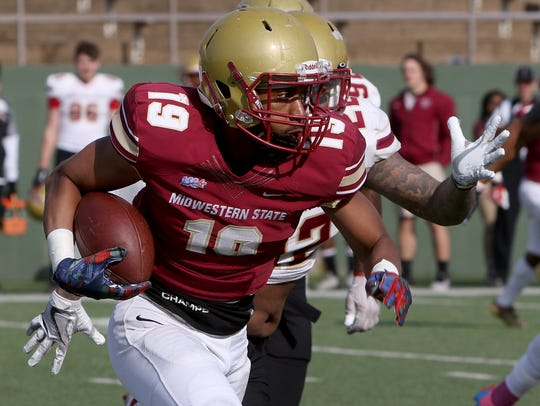 Midwestern State's Anthony Tennison runs around the