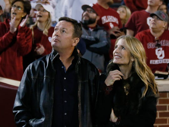 Bob and Carol Stoops check out the scoreboard in a 2017 Oklahoma game. Carol Stoops was so impressed by Kyle Kempt last season that she sent the Iowa State quarterback a hand-written letter.