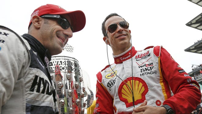 Tony Kanaan and Helio Castroneves talk before the race next to the Borg Warner trophy. Tony Kanaan won the 97th running of the Indianapolis 500 at the Indianapolis Motor Speedway in Indianapolis, IN Sunday, May 26, 2013. (Sam Riche / The Star)Tony Kanaan kisses the bricks and celebrates winning the 97th running of the Indianapolis 500 at the Indianapolis Motor Speedway in Indianapolis, IN Sunday, May 26, 2013. (Sam Riche / The Star)