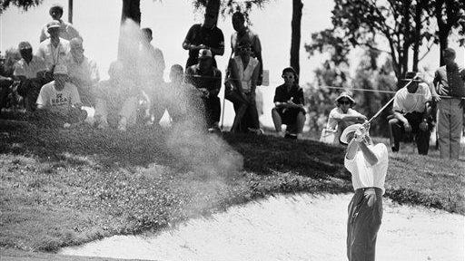 Arnold Palmer pitches from rough toward the green on hole No. 9 at the U.S. Open on June 12, 1958, in Tulsa, Okla. Palmer earlier this year visited Peoria, taking part in an exhibition.