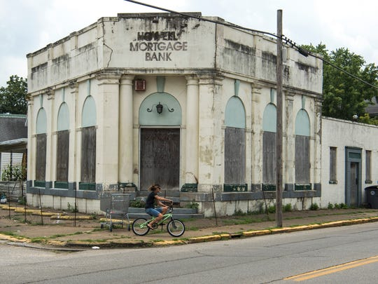 The old Howell Mortgage Bank at the corner of Cumberland and Broadway avenues on Evansville's West Side has fallen into such disrepair, it is in danger of being razed.