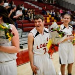Alex Sitzman and his girlfriend Jennifer Schnell, far right, smile as they are recognized at Rocky Mountain's unified senior night Wednesday, Feb. 25, 2015.