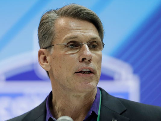 FILE - In this Feb. 28, 2018, file photo, Minnesota Vikings general manager Rick Spielman speaks during a press conference at the NFL football scouting combine, in Indianapolis. Spielman came to this year's annual NFL scouting combine with a quarterback quandary. He has two first-round draft picks trying to recover from injuries. He also has a third-stringer who led the Minnesota Vikings to the NFC championship game. Now Spielman faces one of the most challenging decisions a general manager can as all three could become free agents in less than two weeks. (AP Photo/Darron Cummings, File)