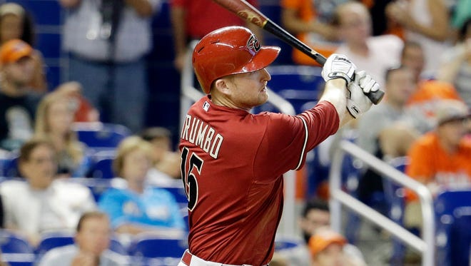 Arizona Diamondbacks slugger Mark Trumbo follows through for  an RBI double in the sixth inning during against the Miami Marlins on Sunday, Aug. 17, 2014, in Miami.