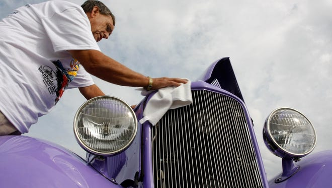 Bob White, of Bentonville, Ark., wipes down his 1933 Ford during a previous O'Reilly Auto Parts Fall Street Machine Nationals.