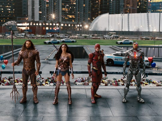 """From left, Jason Momoa, as Aquaman, Gal Gadot, as Wonder Woman, Ezra Miller as the Flash and Ray Fisher as Cyborg during scene in """"Justice League."""""""