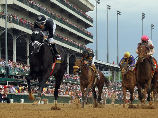 Sharp Azteca, with Edgard Zayas in the saddle, wins the Pat Day Mile at Churchill Downs on Kentucky Derby Day. He is being pointed towards the Haskell Invitational at Monmouth Park.