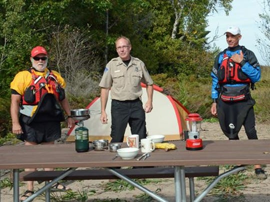 John Browning, Point Beach State Forest supervisor Guy Willman, Russell Johnson and Ken Braband of the Lake Michigan Water Trail Association check out one of the two new water-access kayak campsites on the Point Beach shoreline.