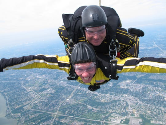Roger Curtis, bottom, got up to speed by going skydiving with Staff Sgt. AaronFigel, a member of the Army Golden Knights jump team, in 2011.