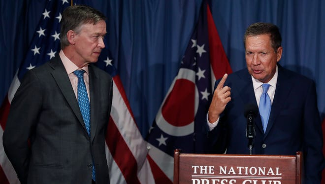 Ohio Gov. John Kasich, joined by Colorado Gov. John Hickenlooper, speaks during a news conference at the National Press Club on June 27, 2017, about Republican health care legislation.