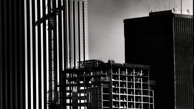 The unfinished Hyatt hotel sits in the foreground with the Lincoln First Tower on the left.