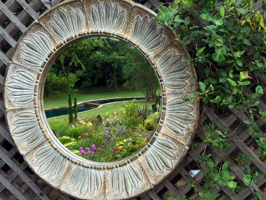Mirror hanging in a seating area reflects a section
