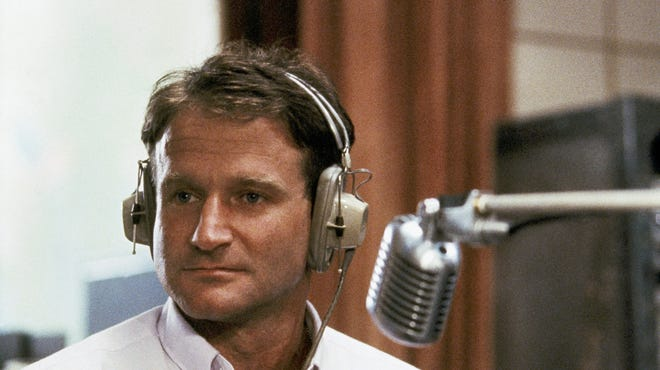 """Actor Robin Williams in character as disc jockey Adrian Cronauer in director Barry Levinson's 1987 comedy-drama """"Good Morning, Vietnam."""""""