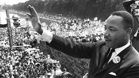 """US civil rights leader Martin Luther King, Jr. waves to supporters in this 28 August 1963 file photo, from the Lincoln Memorial on the Mall in Washington DC, during the """"March on Washington""""."""