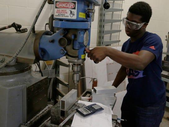 Olukunle Akinleye work in Wave's manufacturing shop.