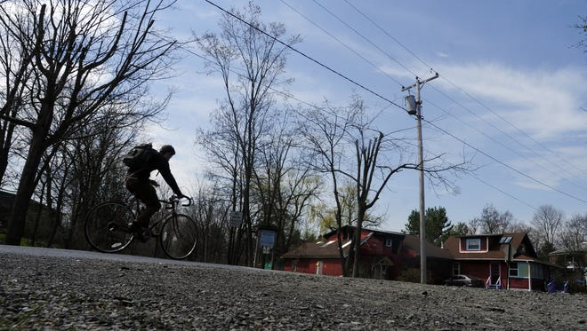 A cyclist, riding on Mulberry Street, crosses the Wallkill Valley Rail Trail on Tuesday in New Paltz. April 22, 2014
