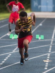 Golden Elite Track Club sprinter, Will Smith, Jr. trains at Washington High School Tuesday afternoon, July 11, 2017, for the upcoming AAU Junior Olympics meet in Detroit. The local track club is sending 36 athletes competition.