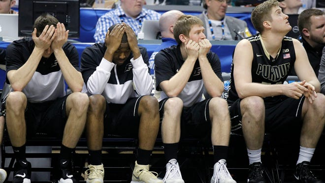 Yhe Purdue bench reacts in the second half of an NCAA college basketball game against Ohio State in the first round of the Big Ten Conference tournament on March 13, 2014, in Indianapolis. Ohio State won 63-61.